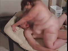 Fat mature enjoying a stiff cock