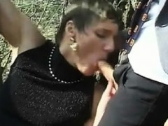 Mature Whore In A Threesome Outside