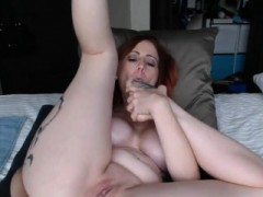 Tattooed Redhead Toys With Her Ass