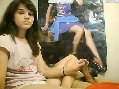 Cute Little Brunette Watches Herself Give Head On Their Web