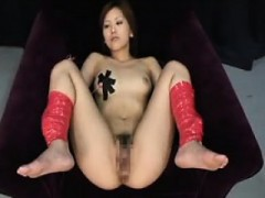 Beautiful Asian Girl Has A Sex Toy Working Its Magic On Her