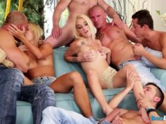 Two Blonde Babe Are Surrounded By Big Cocks